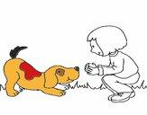 Niña y perro jugando