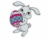 Dibujo Conejo con huevo de pascua pintado por Potte