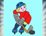 Niño jugando a hockey