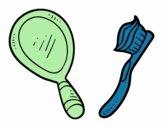 Espejo y cepillo de dientes