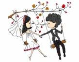 Recién casados en un columpio