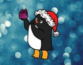 Pingüino con gorro y regalo de Navidad