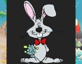 Conejo con ramo de flores