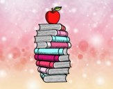 Libros y manzana