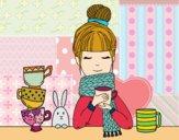 Chica con bufanda y taza de té
